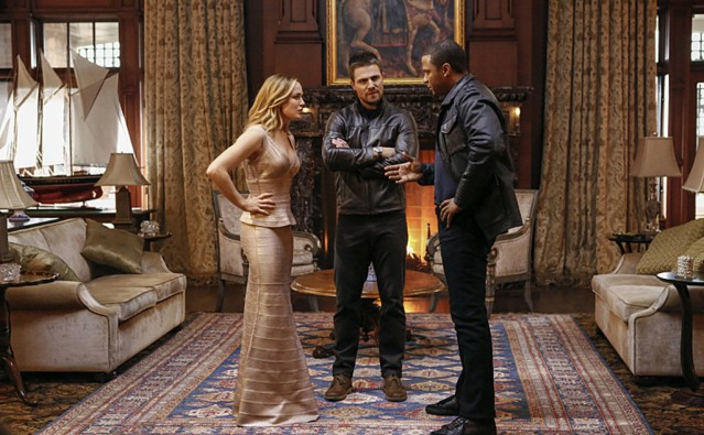 "Caity Lotz, Stephen Amell and David Ramsey in Arrow's 100th episode ""Invasion!"" Photo Credit: Bettina Strauss/The CW"